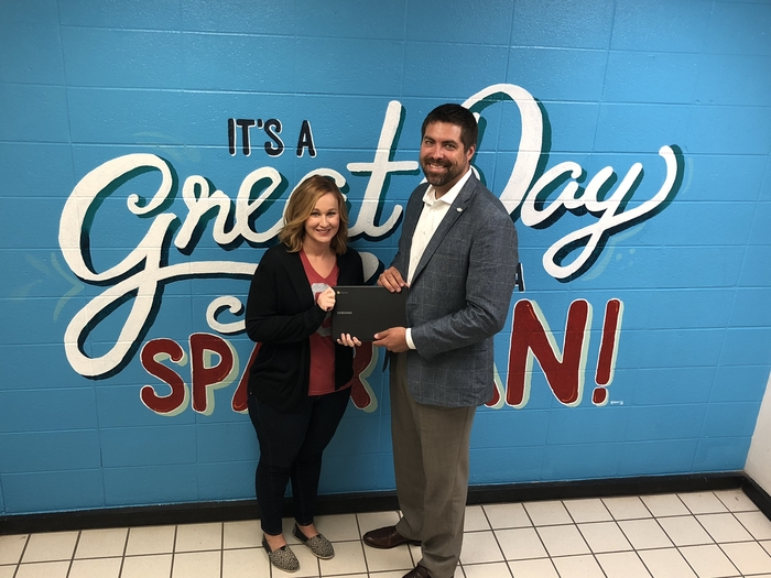 Mrs. Guthrie receiving a new Chromebook!  Thanks to Mr. Constien and Farmers Insurance for supporting our teachers.
