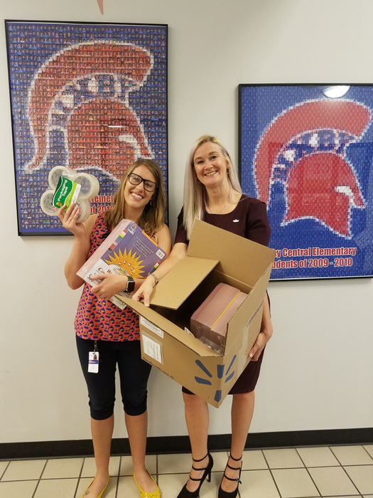 Mrs.Brooks and Robin Decatur with school supplies.