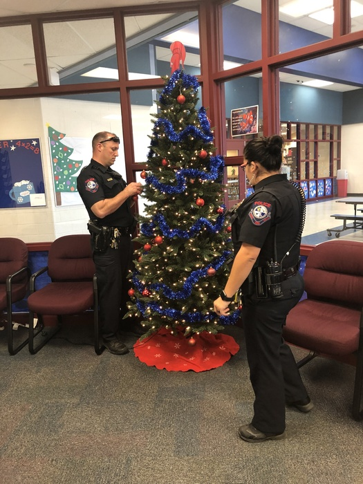 Our office tree being decorated by our SROs!