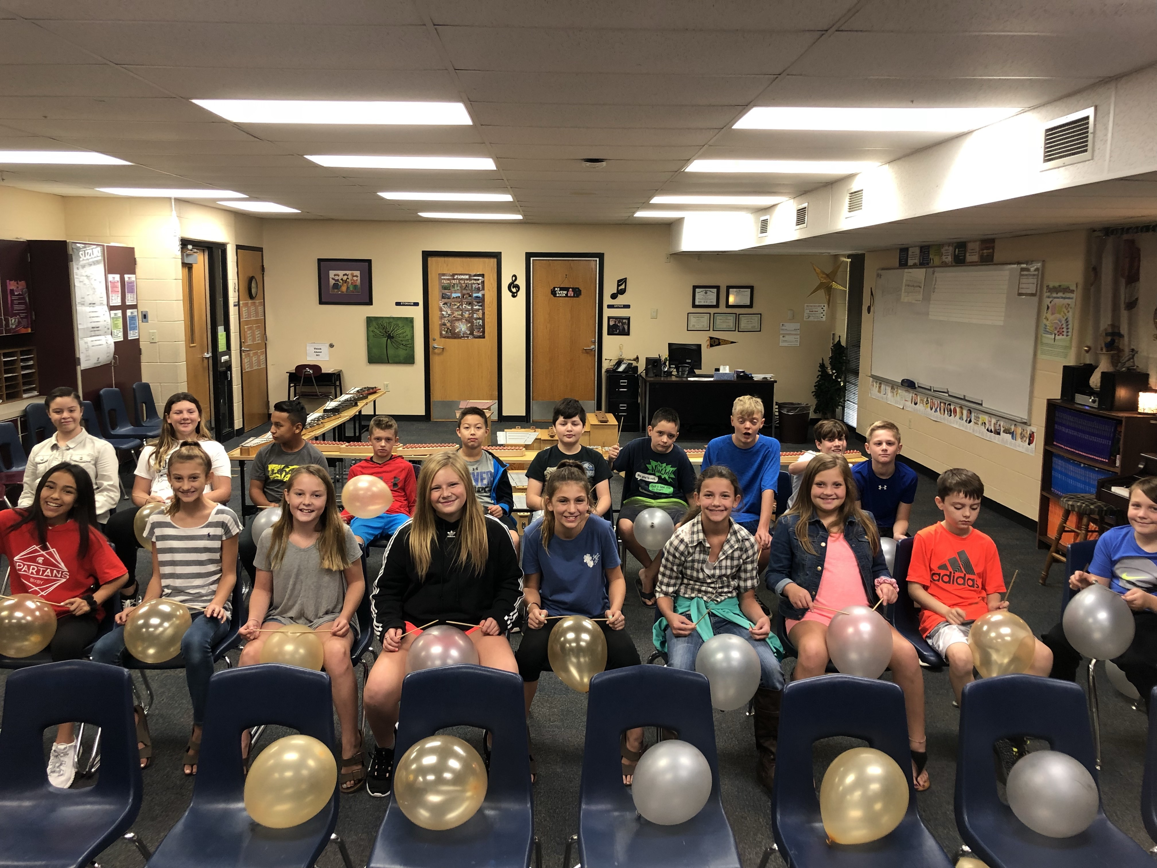 6th grade is learning read rhythms on the board and apply what they learn by playing the rhythms on a balloon with chopsticks.  The activity teaches them to sight read music notation, play as an ensemble, and to use control when playing their instrument so they don't pop their balloons!